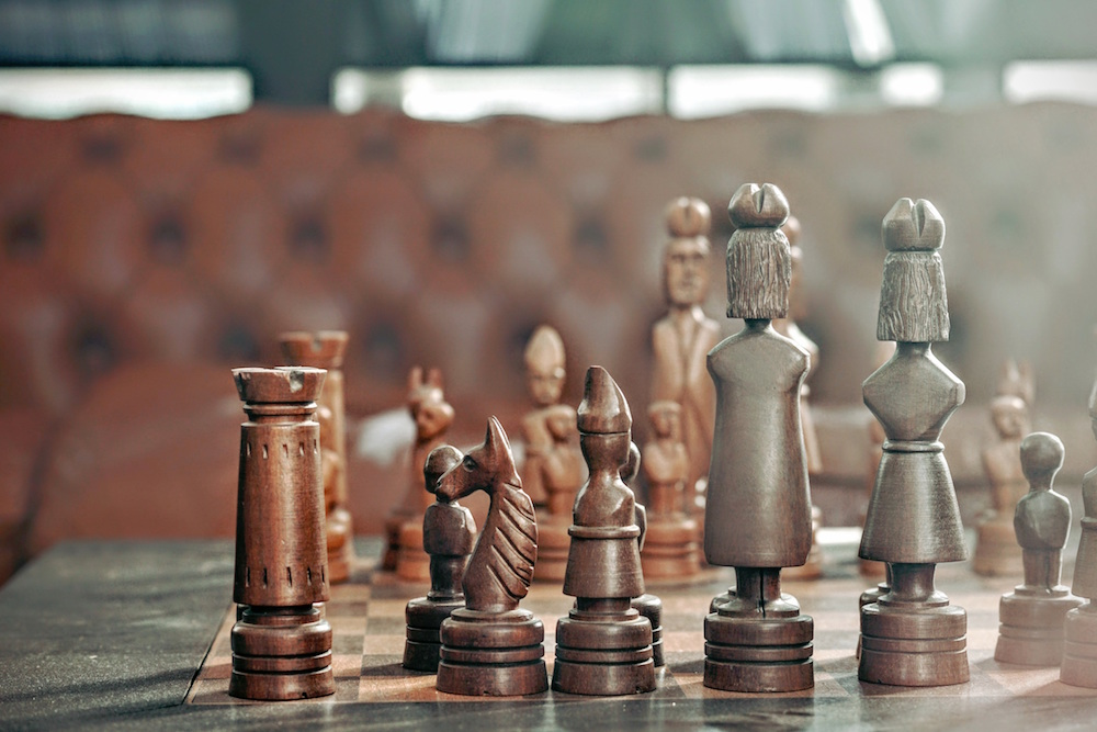 Being pwned has nothing to do with chess pieces
